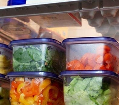 chopped salad ingredients in tupperware containers