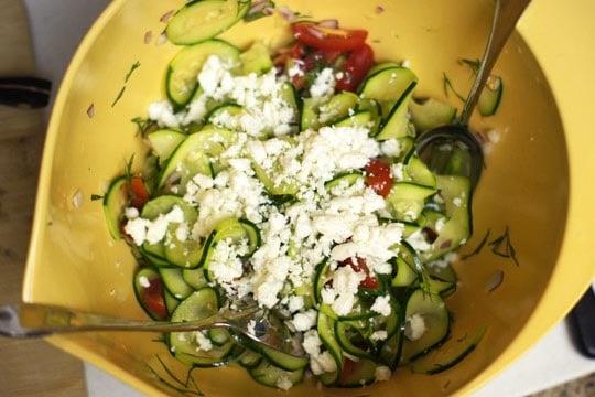 mediterranean zucchini pasta salad mixed in a bowl