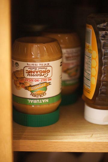 upsidedown jar of natural creamy organic peanut butter