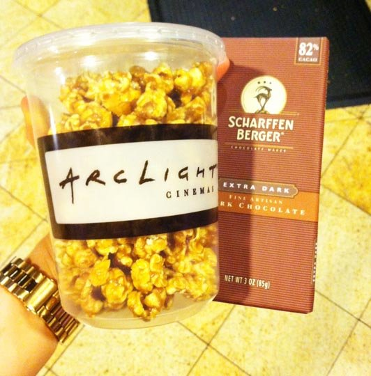 bucket of popcorn and a bar of dark chocolate
