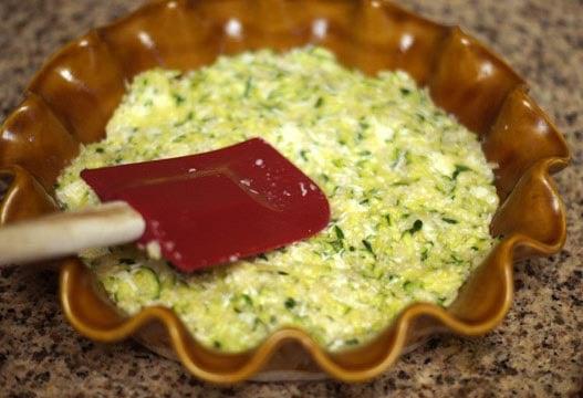 flourless zucchini pie pressed into a pie dish
