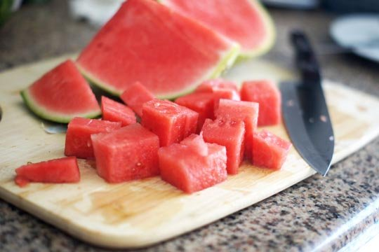 watermelon cut on a cutting board