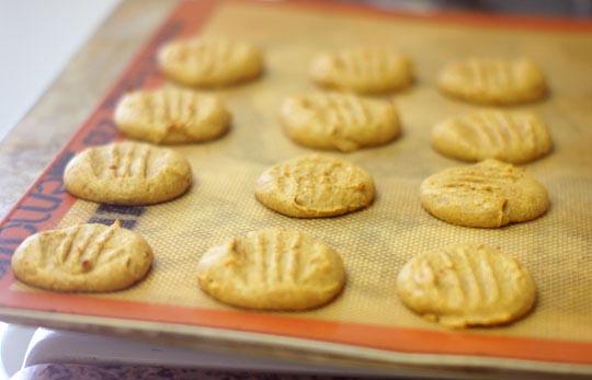 baked pumpkin pie cookies on a baking sheet