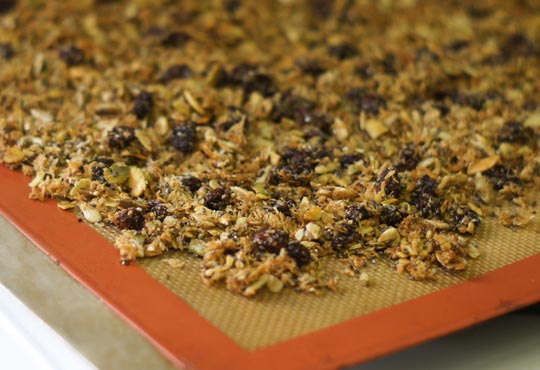 baked pumpkin seed granola on a pan