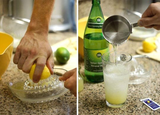 juicing a lemon and puring it into a glass