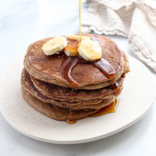 paleo pancakes with banana slices on top