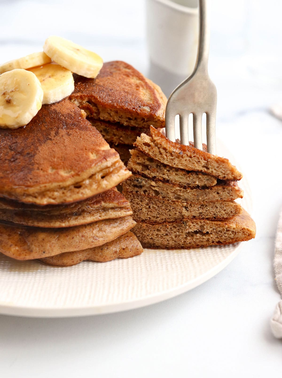 fork in a stack of paleo pancakes