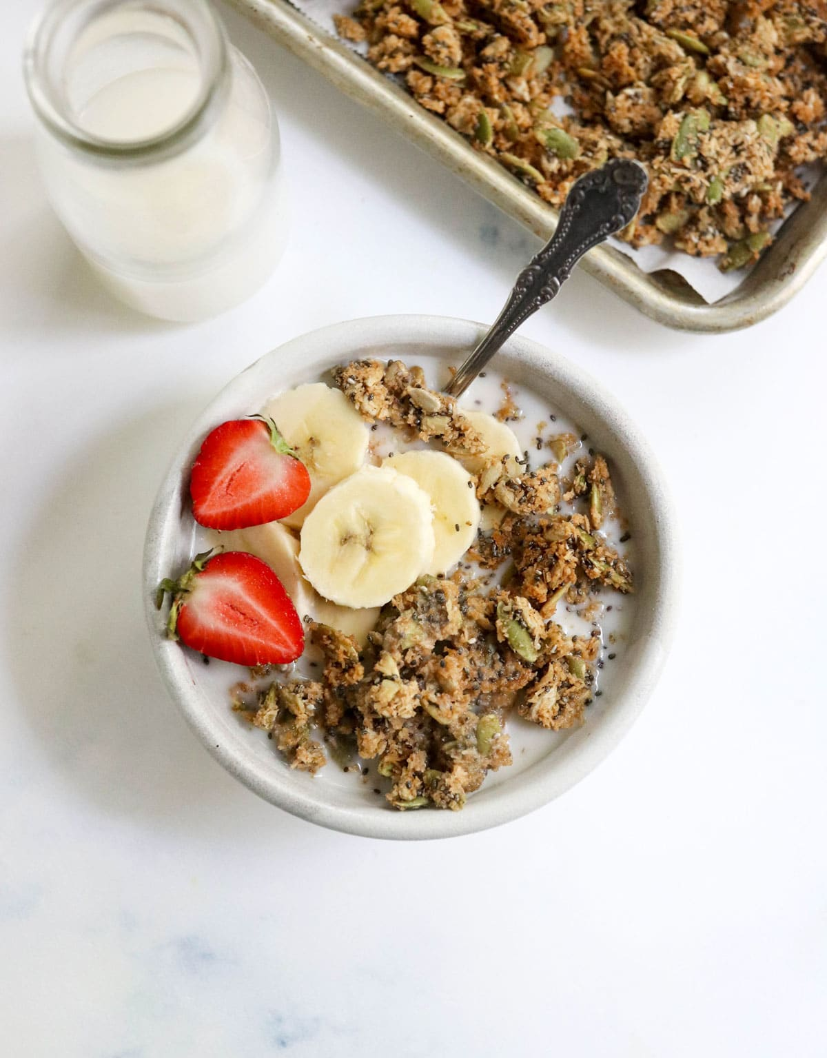 pumpkin seed granola in bowl with fruit on top