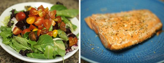 plate of salad and a oven-roasted salmon on a plate