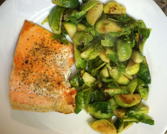 salmon and brussels sprouts on a plate