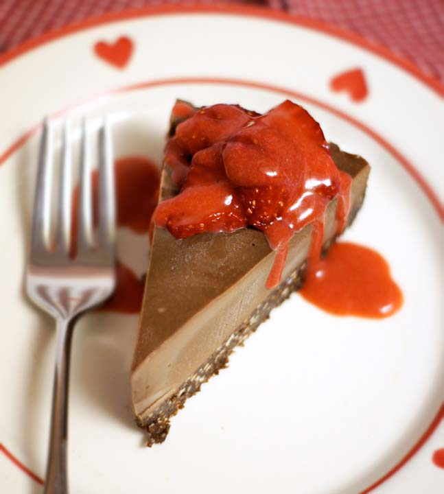 Raw Chocolate Cheesecake with strawberry sauce on top