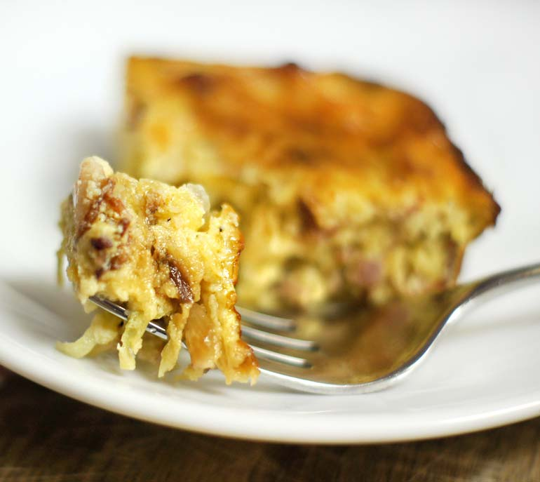 fork full of bacon and gruyere egg casserole