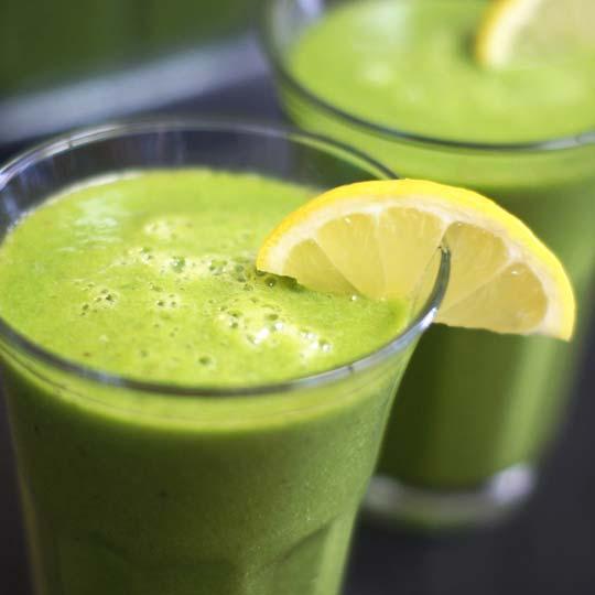 green tea lemonade in a glass with a lemon slice