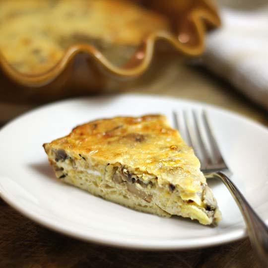 slice of mushroom and gruyere pie
