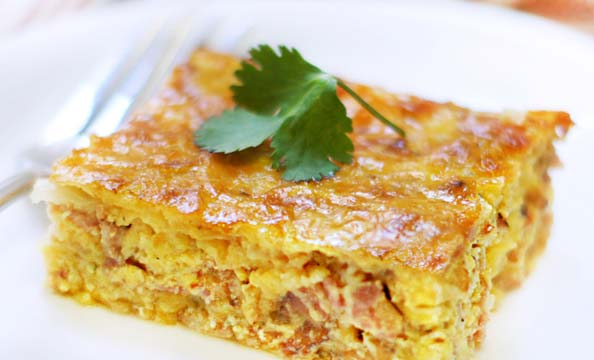 slice of bacon and gruyere egg casserole