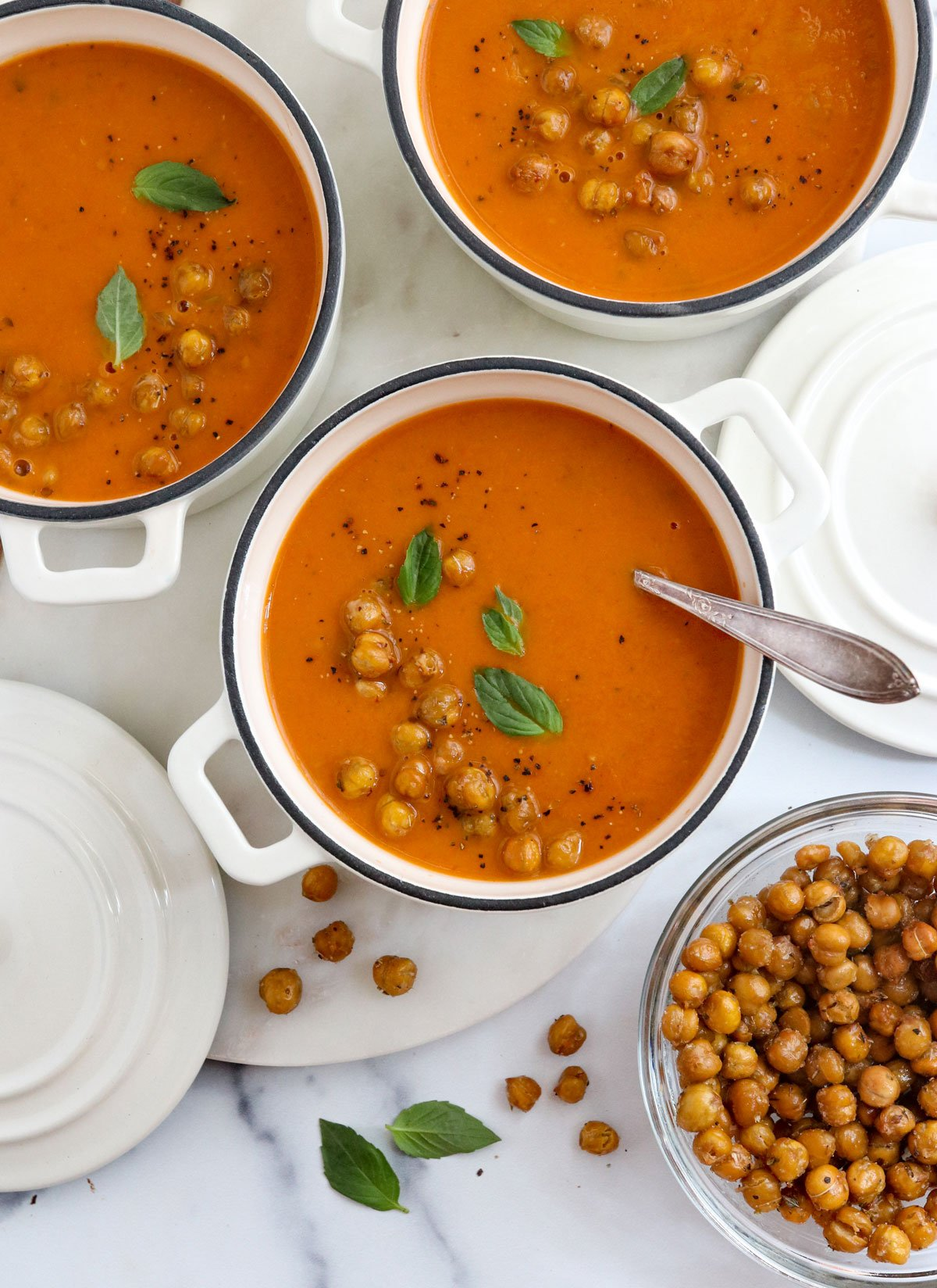 roasted tomato soup in 3 white bowls