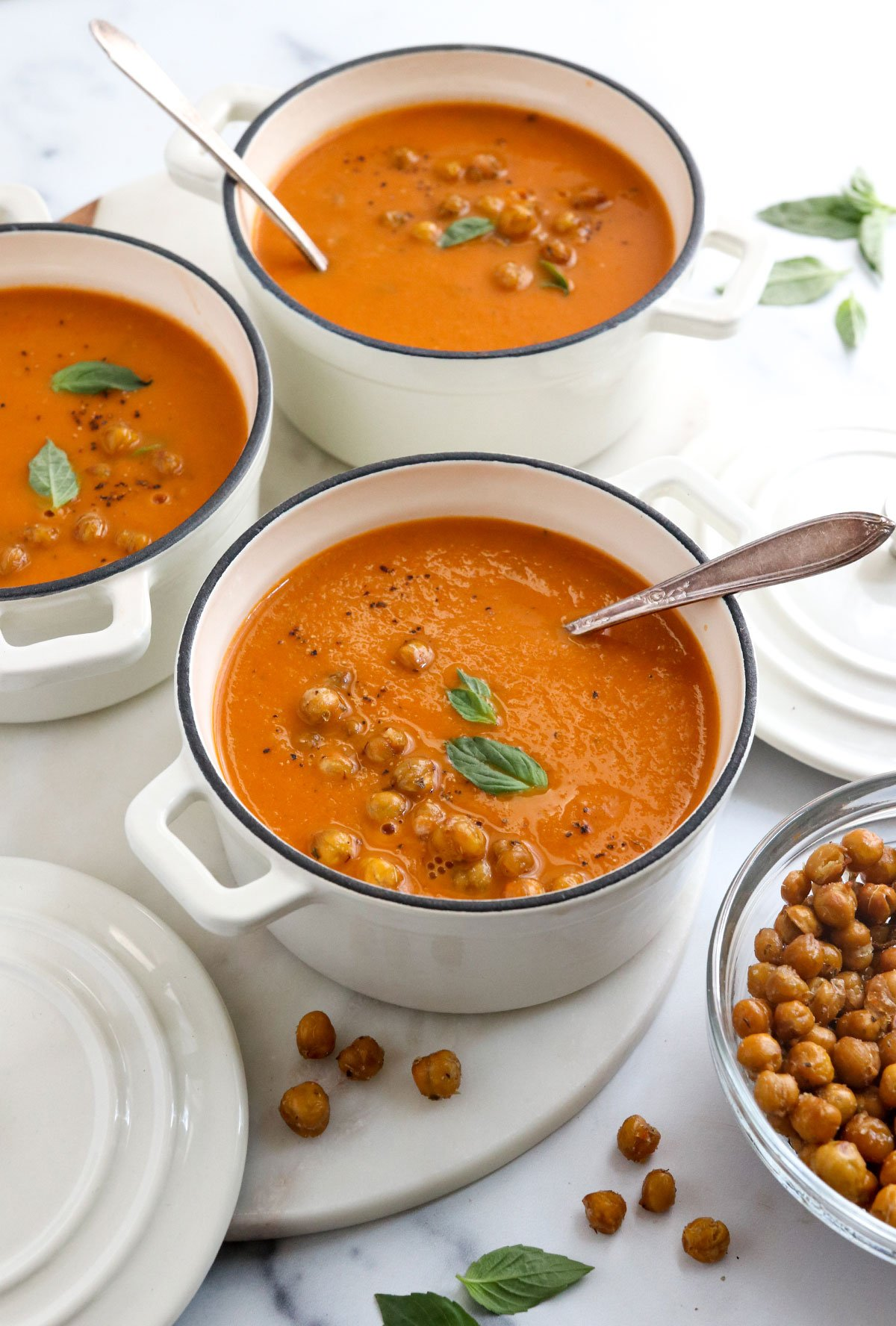 roasted tomato soup with chickpeas and basil on top