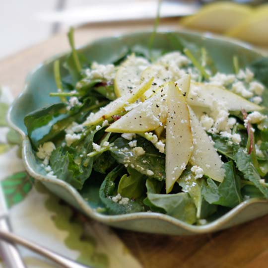 kale, pear, and feta salad in a bowl
