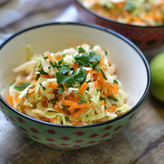 sweet sesame-lime cabbage salad in a bowl