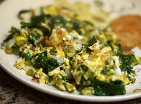 plate of fried eggs with spinach