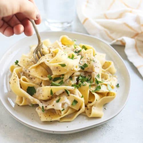 cauliflower alfredo pasta with fork