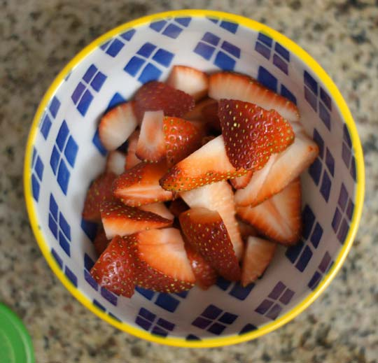 strawberry slices in a bowl