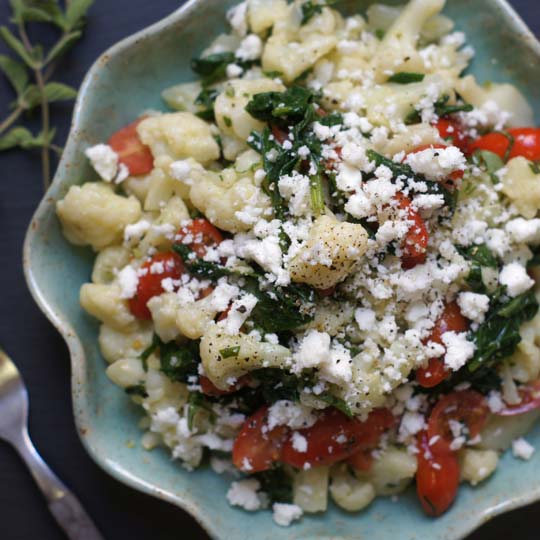 greek cauliflower pasta salad on a plate