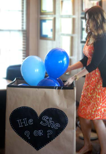 baby gender reveal with blue ballons