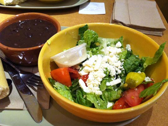bowls with soup and salad