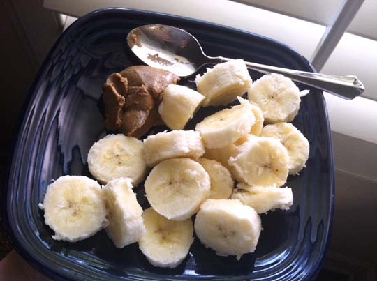 banana slices on a plate with almond butter