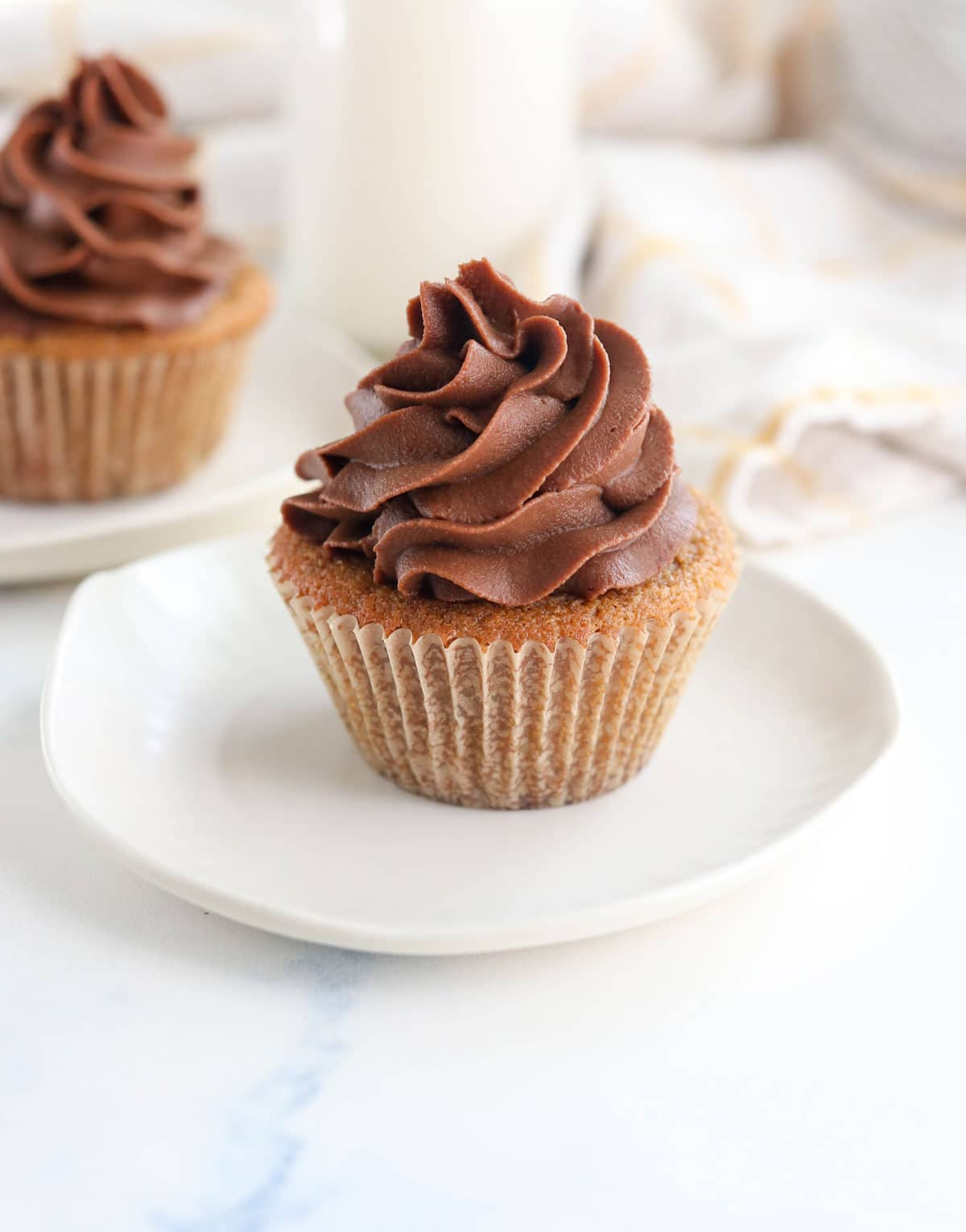 coconut flour cupcake with chocolate piped frosting