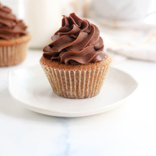 coconut flour cupcakes on white plate with chocolate frosting