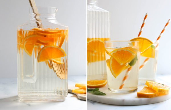 oranges stirred into water and served in glasses