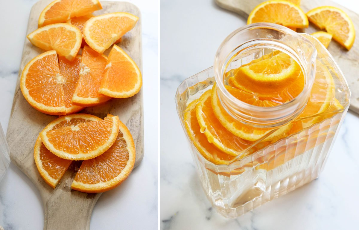 sliced oranges added to pitcher of water