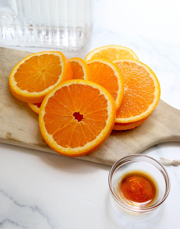 orange slices on cutting board