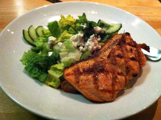 plate with salad and grilled salmon