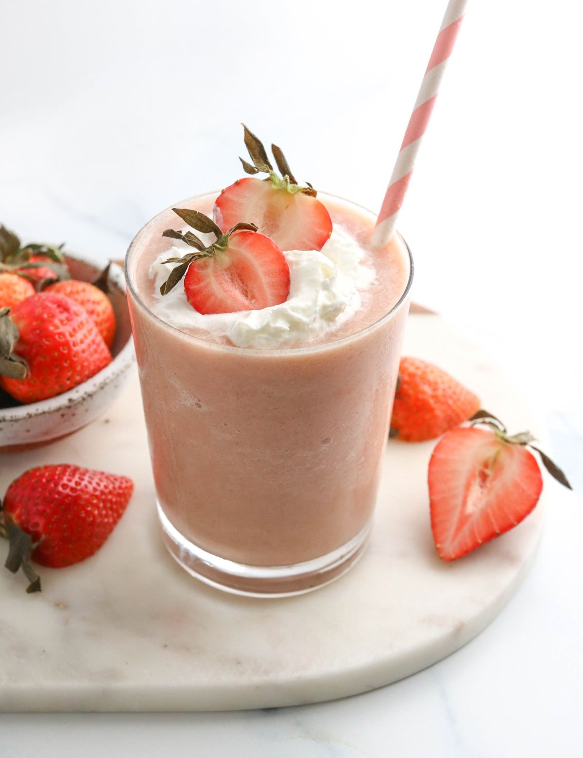 healthy strawberry milkshake with whipped cream on top