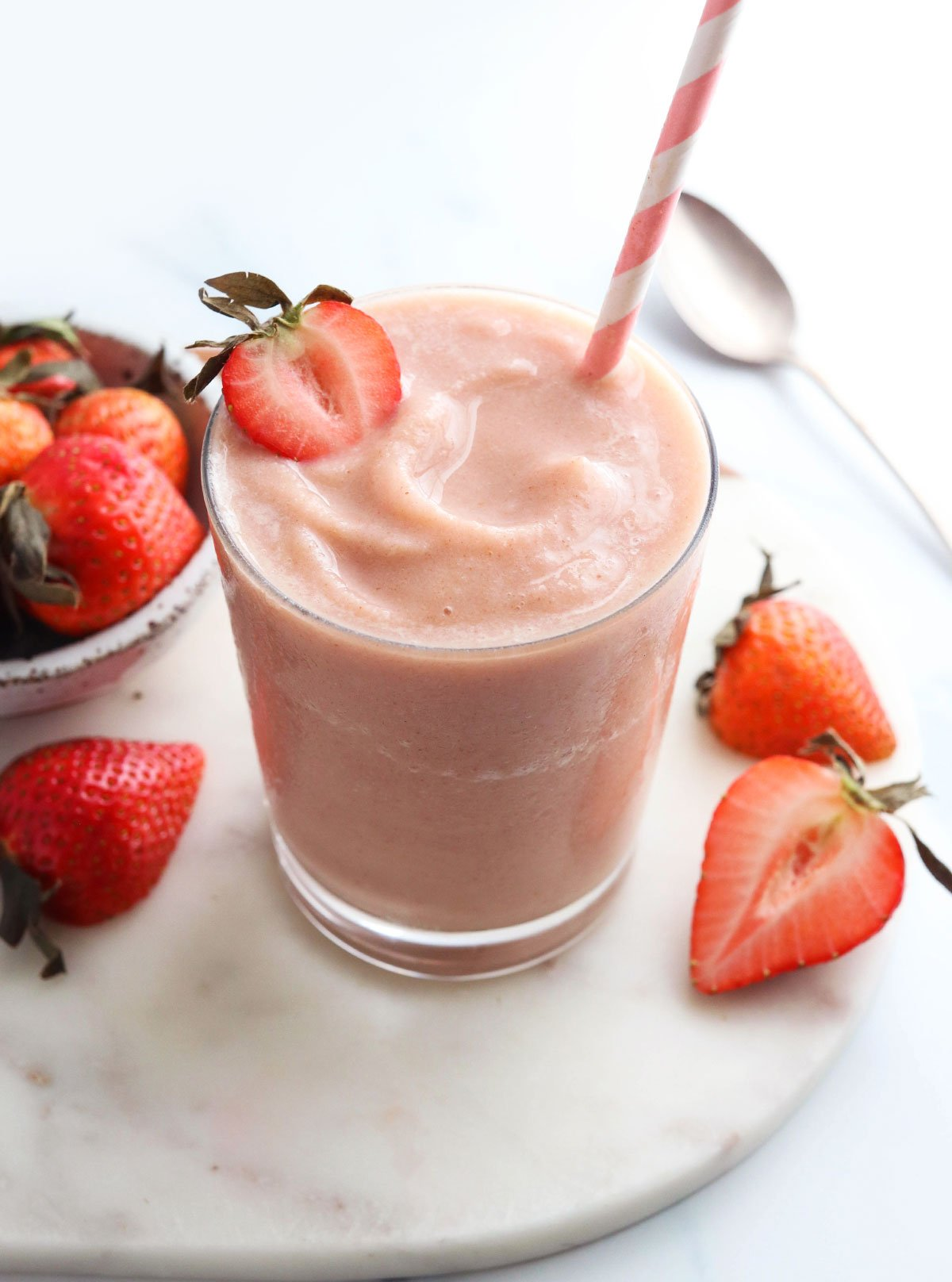 strawberry smoothie with strawberry on top