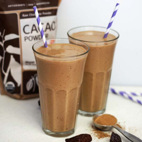 chocolate coconut milkshakes in glasses with straws