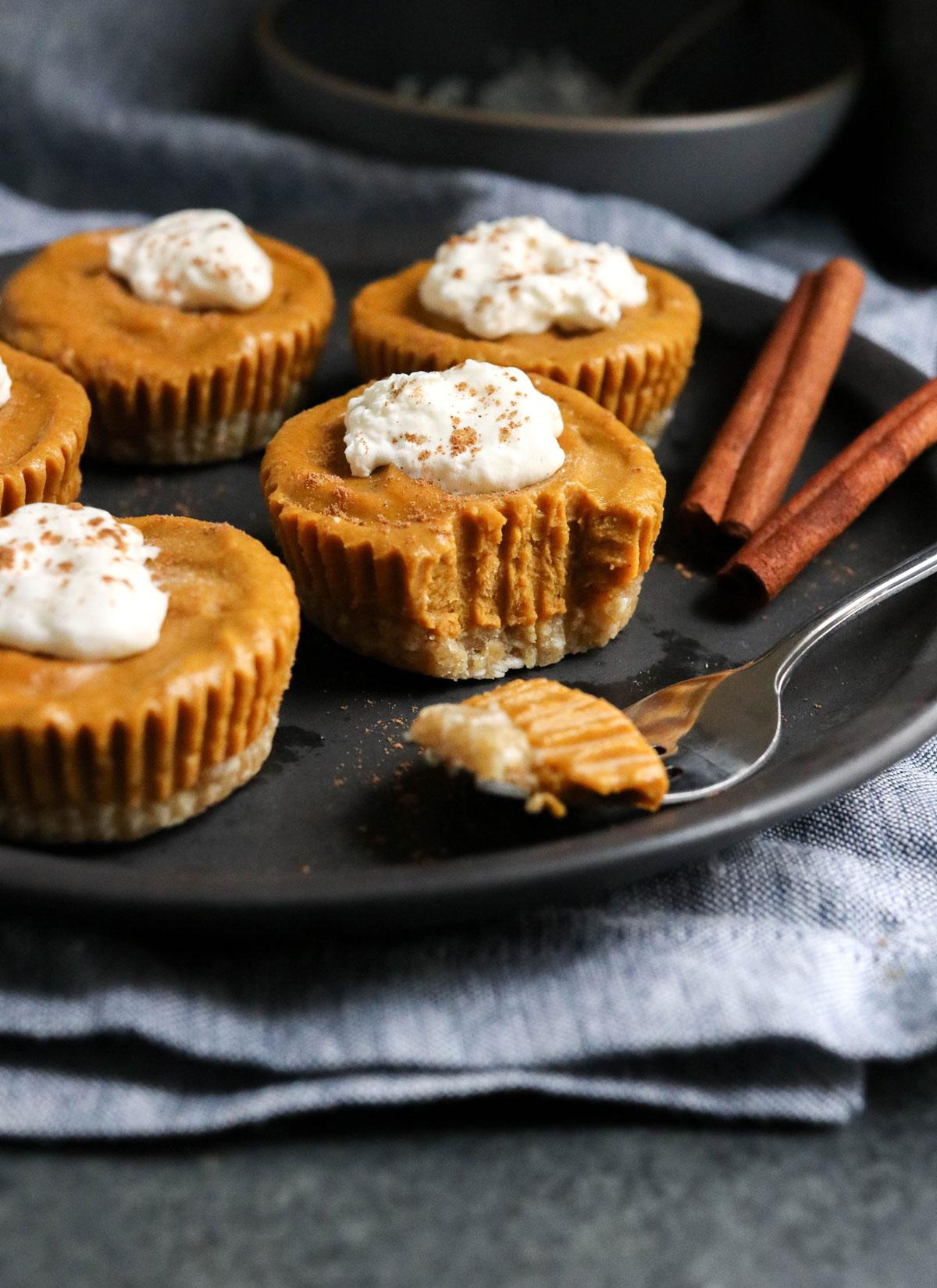 vegan pumpkin tarts on black plate