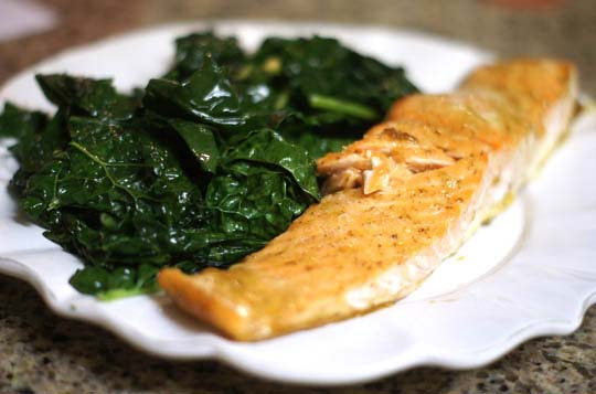 plate with salmon and steamed kale