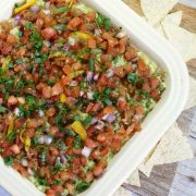 healthy mexican layer dip in a square dish