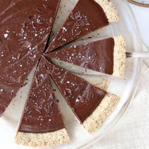 vegan chocolate tart sliced in pan