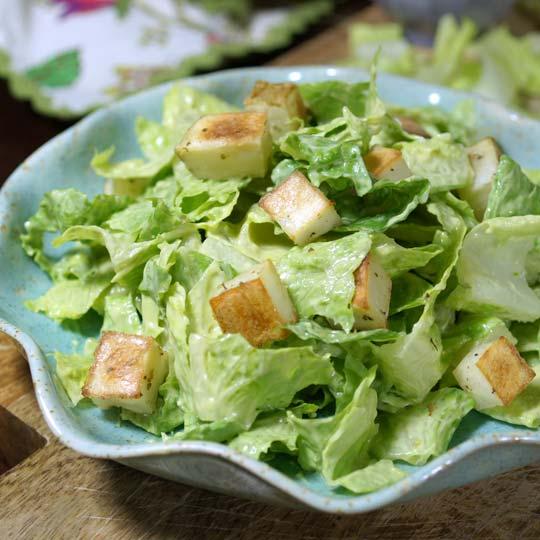 avocado caesar salad in a bowl