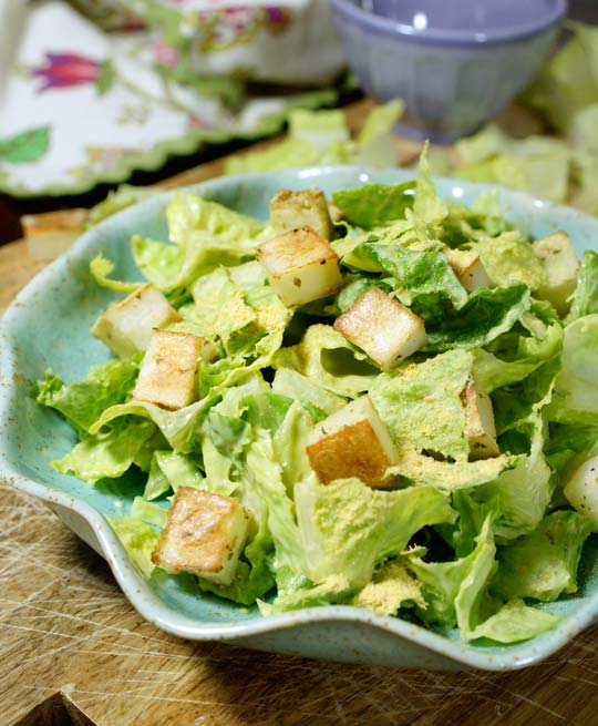 avocado caesar salad in a bowl