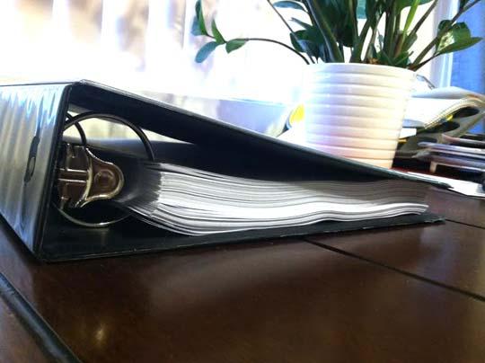 binder with a manuscript