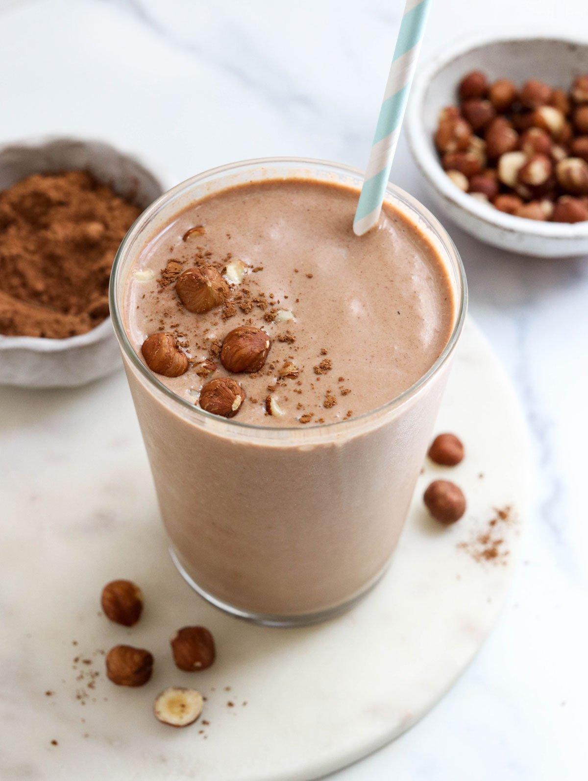 chocolate hazelnut smoothie in glass with straw