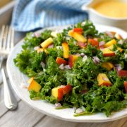 Kale salad with peaches and onions