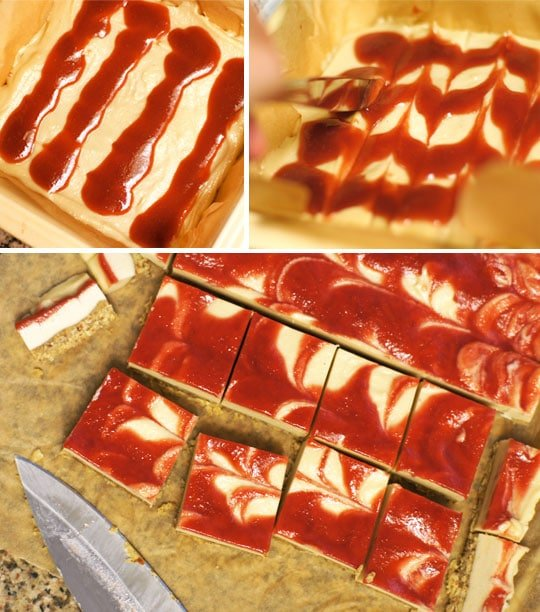 putting strawberry sauce on top of cheesecake bars