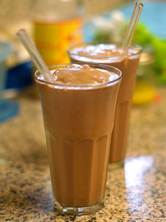 chocolate banana protein shake in glasses with straws